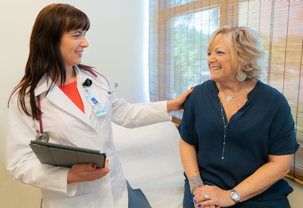 Dr. Claudia Perdei with a patient